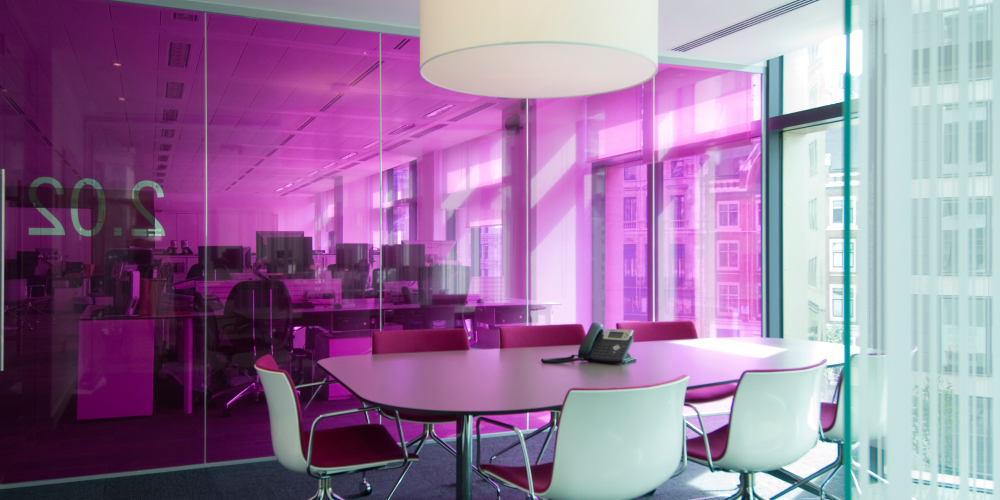 Workplace analysis and space planning - meeting room interior with coloured glass film