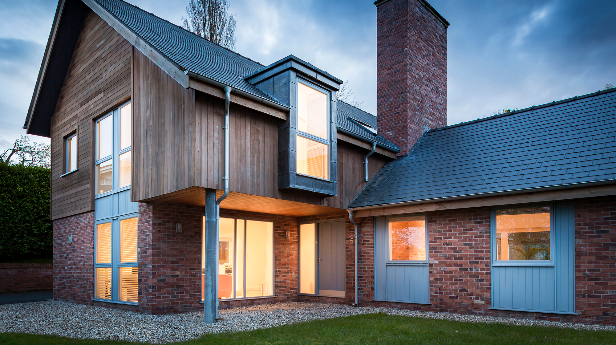 Contemporary residential property - front view of private house exterior at dusk
