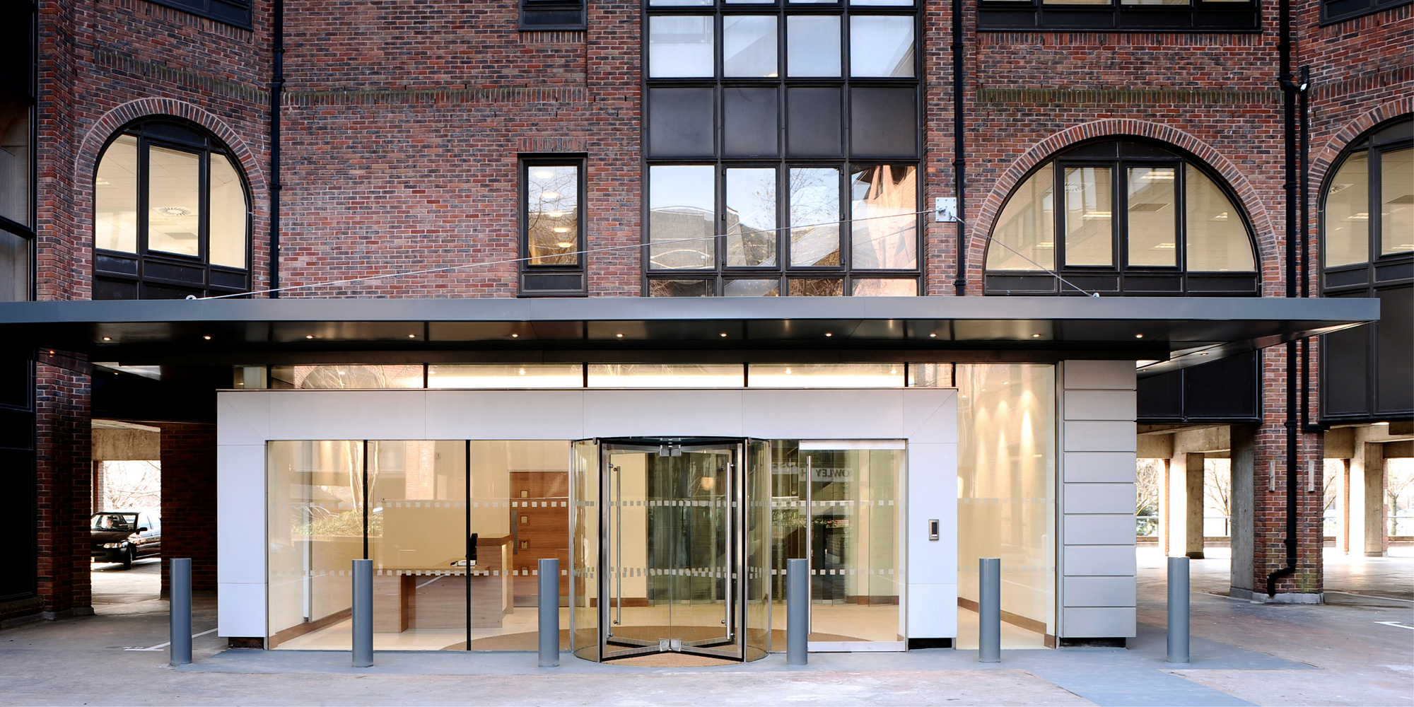 Cat A refurbishment including reception - remodelled entrance using steel, glass and zinc cladding