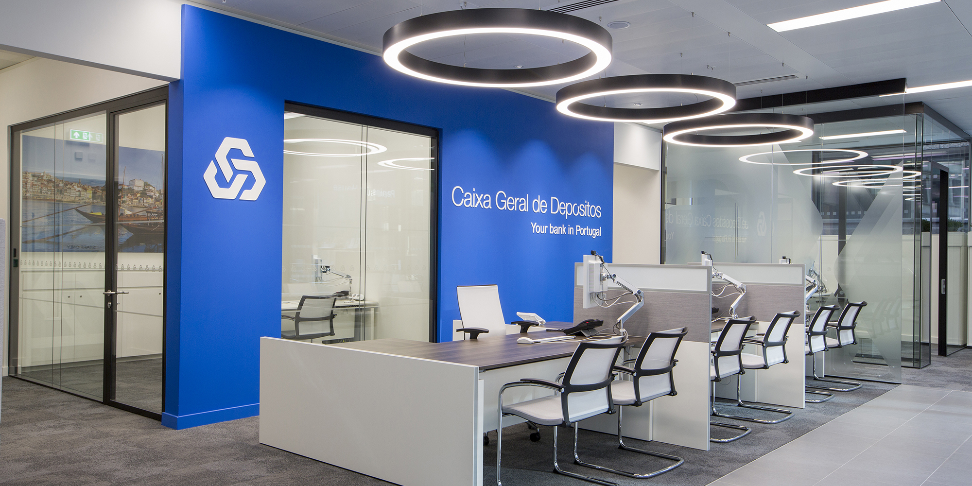 Design and branding for Caixa customer suite in London - customer service area with feature lighting