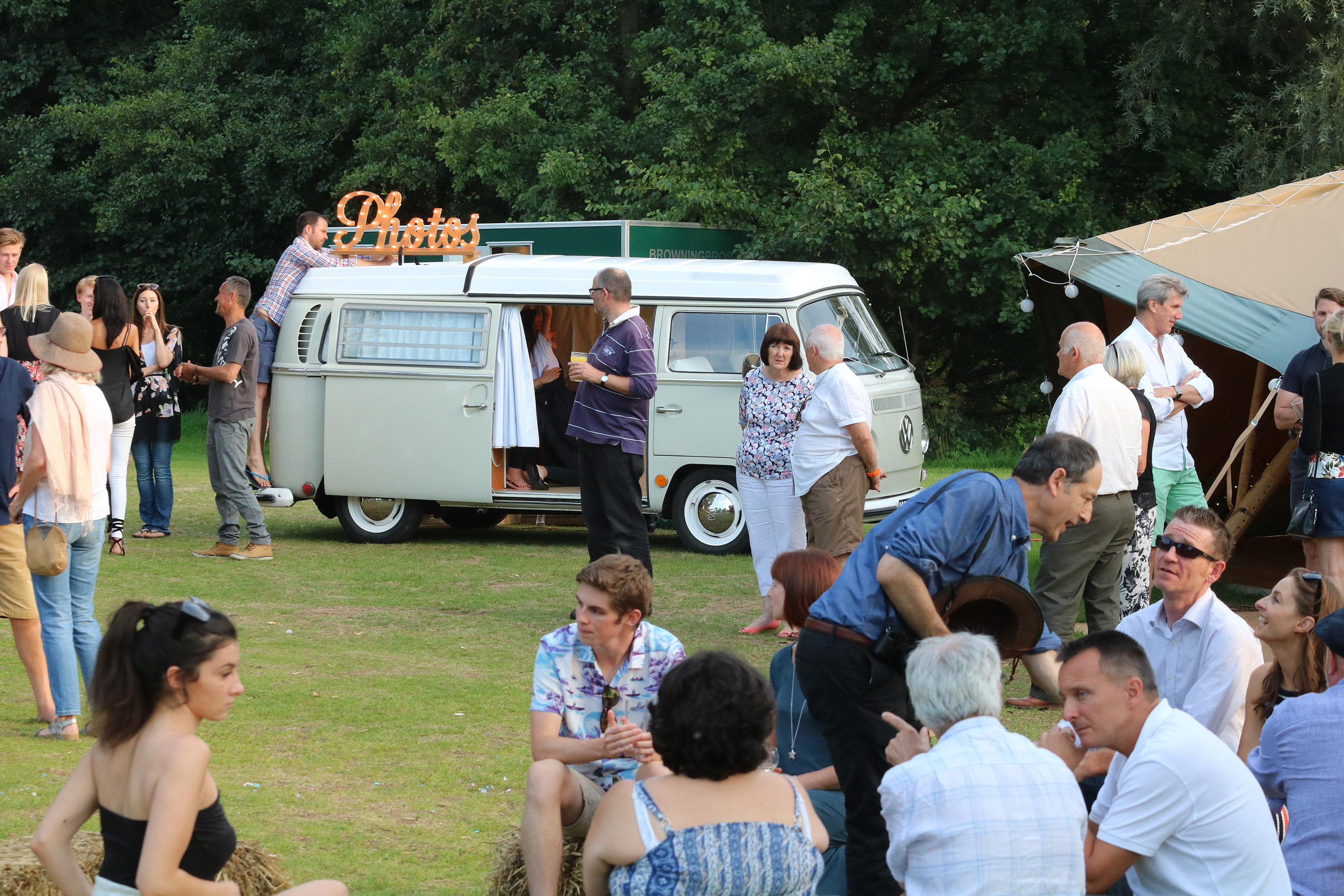 Mansfield Monk 25th anniversary celebrations - outdoor agthering of people by VW camper van photo booth